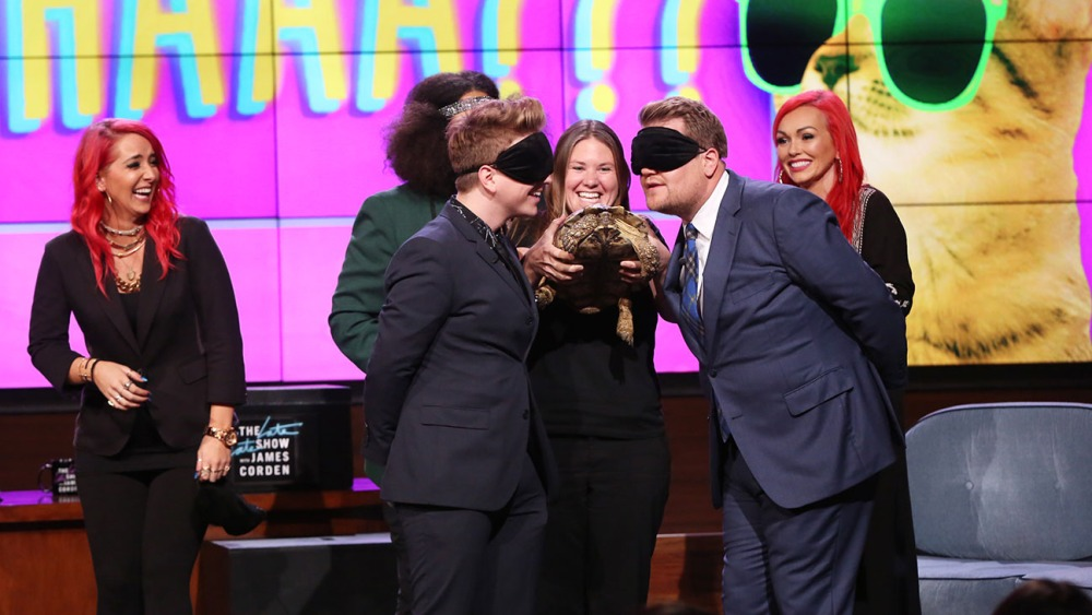 "Reggie Watts leads James Corden, Jenna Marbles, Tyler Oakley and Kandee Johnson in a game of ""Nuzzle Whaaa????"" at YouTube Space LA for ""The Late Late Show with James Corden,"" airing Friday, August 21 (12:37 – 1:37 AM, ET/PT) on the CBS Television Network. Photo: Monty Brinton/CBS ©2015 CBS Broadcasting, Inc. All Rights Reserved"
